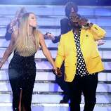 """Judges Mariah Carey, left, and Randy Jackson walk on stage at the """"American Idol"""" finale at the Nokia Theatre at L.A. Live on Thursday, May 16, 2013, in Los Angeles. (Photo by Matt Sayles/Invision/AP)"""
