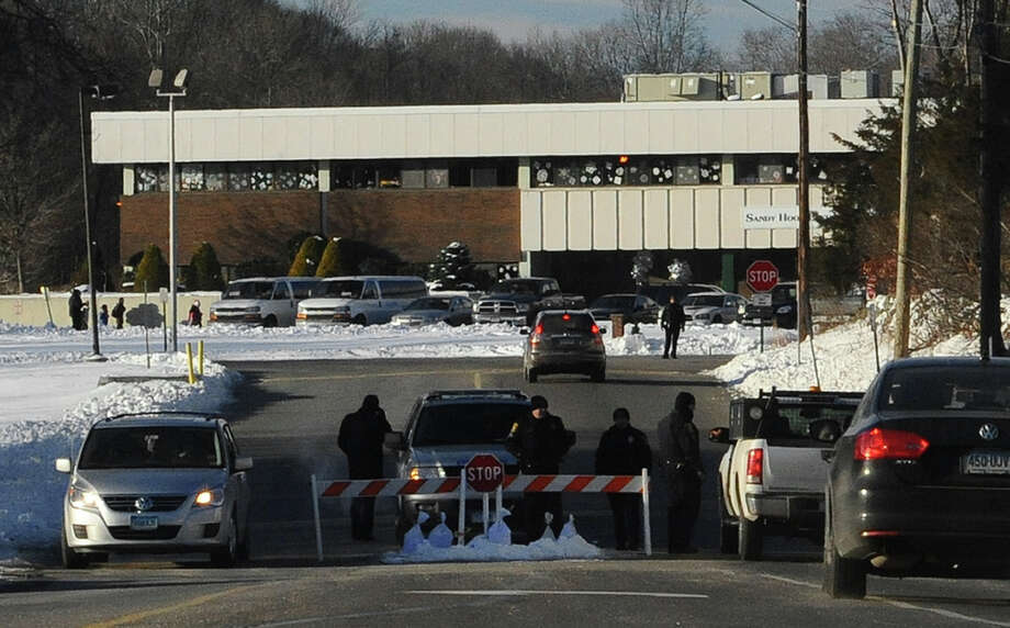 A police road block is at the entrance to the new Sandy Hook Elementary School on the first day of classes in Monroe, Conn., Thursday, Jan. 3, 2013. The school, formerly known as Chalk Hill School, was overhauled specially for the students from the Sandy Hook School shooting in Newtown, in the neighboring town of Monroe, Conn. (AP Photo/Jessica Hill) Photo: Jessica Hill, Associated Press / FR125654 AP