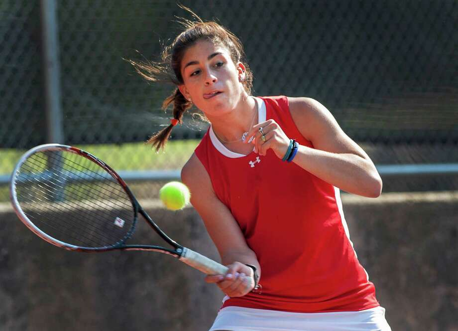 Greenwich high school's Jenn DeLuca returns a shot by Ridgefield high school's Kelly Janasek in an FCIAC quarterfinal girls tennis match played at Greenwich high school, Greenwich, CT on Thursday May 16th, 2013. Photo: Mark Conrad / Stamford Advocate Freelance