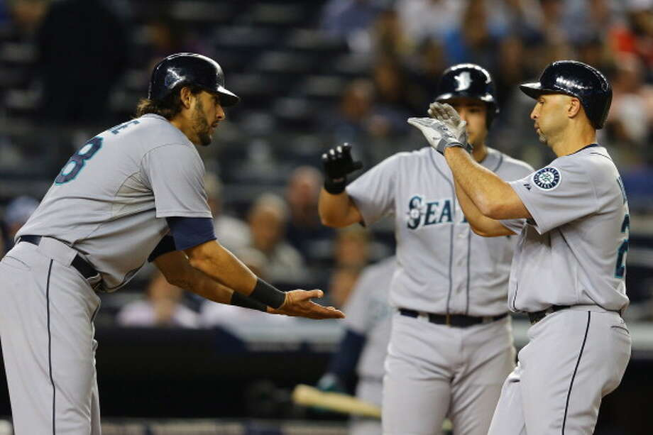 Highest scoring M's games through historyRaul Ibanez, right, had a monster day Wednesday as the M's beat the Yankees 12-2. He hit a grand slam and a two-run homer against his former team and the New York fans, helping the Mariners to their highest scoring game so far this season.  It got us thinking about big Mariners wins throughout the team's 37-year history. What were the highest scoring games in each season? Click through the gallery to find out.  Photo: Al Bello, Getty Images / 2013 Getty Images