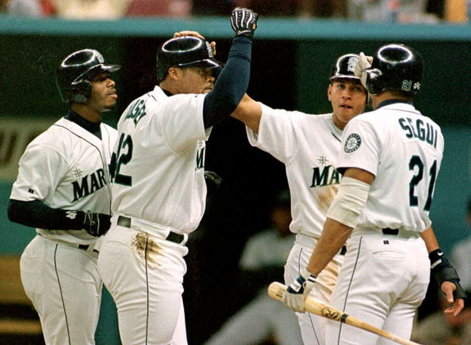 1999: April 29 – Detroit Tigers 6, at Mariners 22  This one remains the Mariners' franchise record for runs in a single game. Seattle scored 11 runs in the bottom of the fifth, then six in the sixth. Ken Griffey Jr. had six RBI on two home runs -- one of them a grand slam -- and dingers also came off the bats of David Bell and pinch-hitting Matt Mieske. Russ Davis and Rafael Bournigal each hit two doubles.  Photo: DAN LEVINE, AFP/Getty Images / AFP