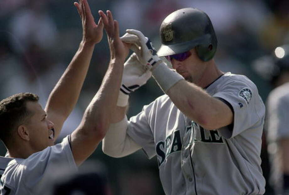 2000: Sept. 30 – Mariners 21, at Anaheim Angels 9Alex Rodriguez hit two home runs and finished 4-for-6 with seven RBI. Edgar Martinez, Jay Buhner and David Bell each homered once, Joe Oliver hit a triple and Mark McLemore hit two doubles in this 22-hit rout.  Also of note, the 2000 Mariners beat the Blue Jays 17-6 and 19-7 in two-consecutive games in Toronto on April 15 and 16, respectively.  Photo: Jeff Gross, Getty Images / Getty Images North America