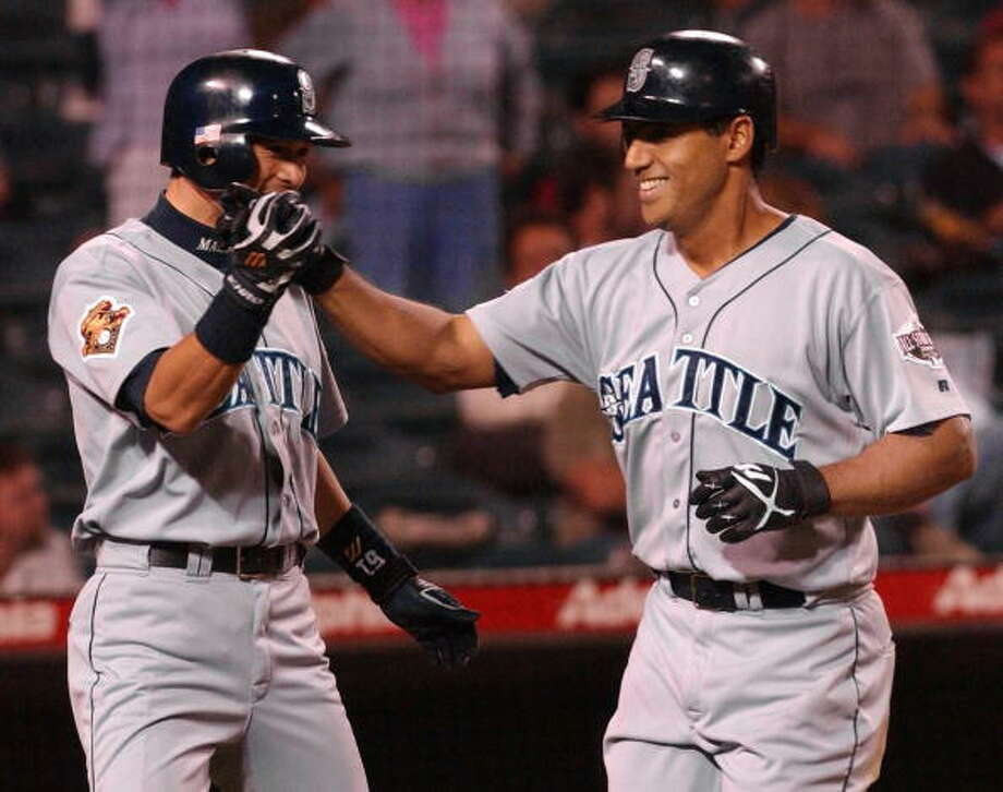2001:Two games with 16 runsAug. 22 – Detroit Tigers 1, at Mariners 16The M's jumped out to a 13-0 lead after three innings, and that was all it took. John Olerud hit two home runs, Bret Boone and David Bell added one each, and Edgar Martinez finished with two doubles and five RBI.   Oct. 4 – Texas Rangers 1, at Mariners 16  For their 114th win of the season, the Mariners slapped a lot of doubles around Safeco Field to blow out the Rangers. Catcher Tom Lampkin had four RBI on two doubles, and joining the double-party were Mark McLemore, John Olerud, Al Marin and pinch-hitting Ed Sprague. Jay Buhner also hit a two-run homer.  Mariners fans may also remember an ugly loss in Cleveland on Aug. 5, 2001, when the M's took a 14-0 lead after five innings but ended up losing 15-14 to the Indians.  Photo: LUCY NICHOLSON, AFP/Getty Images / AFP