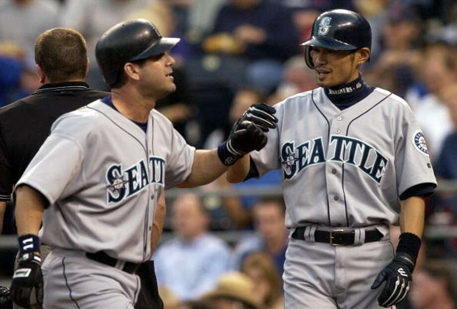 2003: May 27 – Mariners 15, at Kansas City Royals 7  The M's had an 11-0 lead after three innings and finished the game with 20 hits. Edgar Martinez had five RBI on two home runs, Ben Davis and John Mabry hit dingers themselves, and Randy Winn went 5-for-5 with a double.  Photo: DAVE KAUP, AFP/Getty Images / 2003 AFP