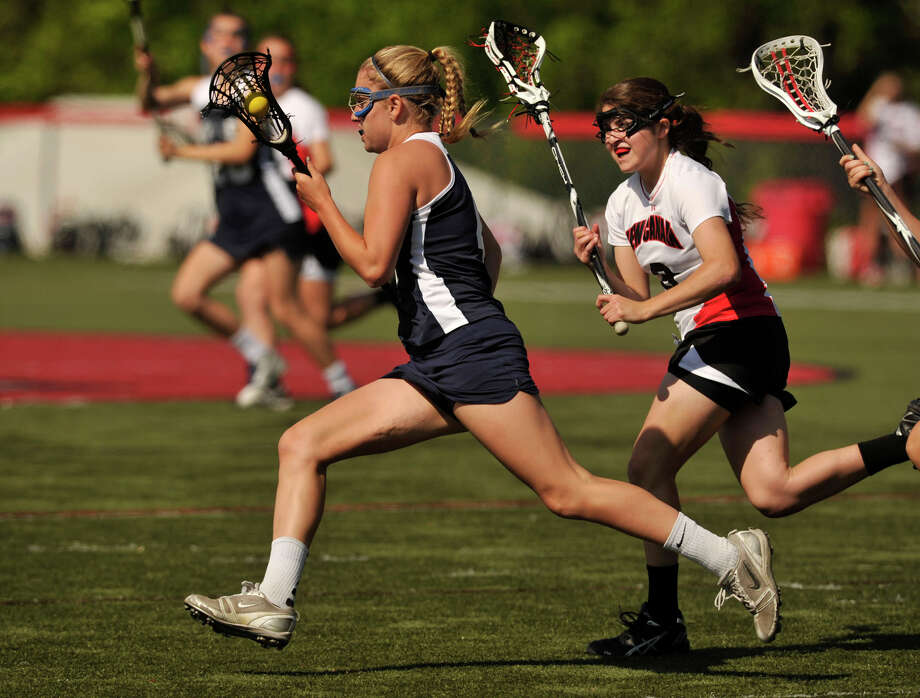 Staples' Jenna McNicholas runs with the ball down thhe field during their FCIAC quarterfinal game against New Canaan at New Canaan High School on Thursday, May 16, 2013. New Canaan won, 12-5. Photo: Jason Rearick / Stamford Advocate