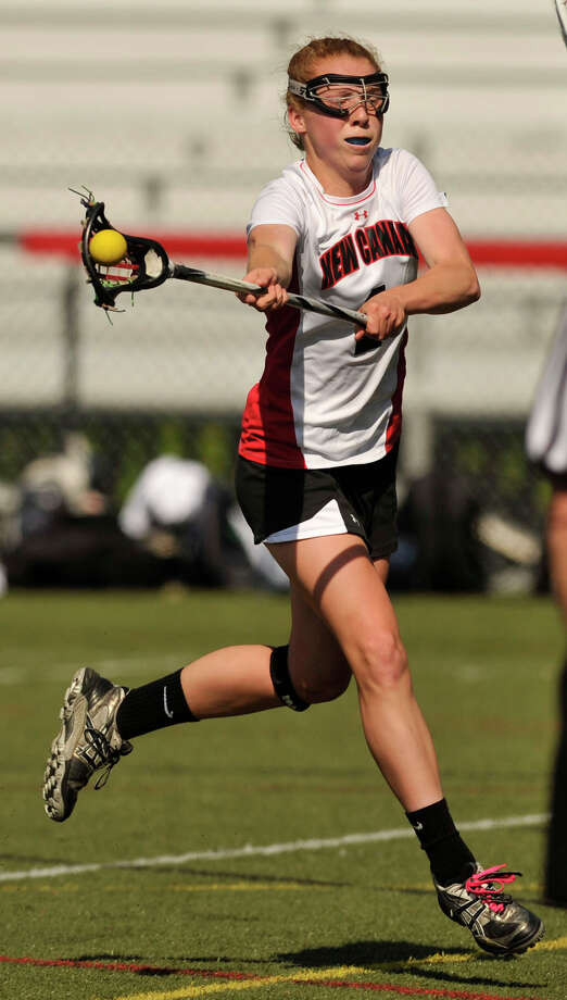 New Canaan's Elizabeth Miller shoots and scores on the Staples goalie during their FCIAC quarterfinal game at New Canaan High School on Thursday, May 16, 2013. New Canaan won, 12-5. Photo: Jason Rearick / Stamford Advocate