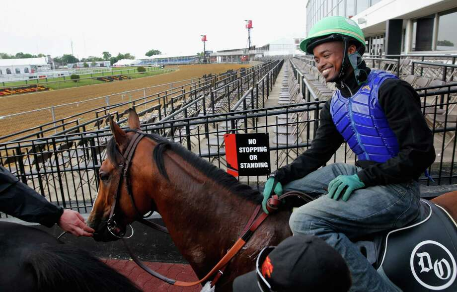 A victory in the Preakness Stakes would be money in the bank for jockey Kevin Krigger and Goldencents. Photo: Rob Carr, Staff / 2013 Getty Images