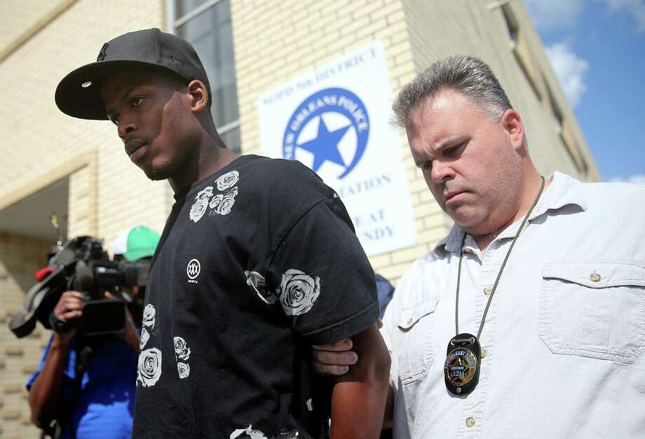 Shawn Scott, left, who with his brother Akein is accused of the Mother's Day second-line shooting, is moved to the Orleans Parish Prison in New Orleans. Photo: MICHAEL DeMOCKER, MBR / NOLA.COM