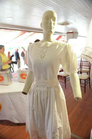 An antique dress is displayed at a press conference celebrating the 150 years of the Saratoga Race Course during a press conference at the track on Thursday, May 16, 2013 in Saratoga Springs, N.Y. Committee Honorary Chairs and Chairman held the news conference to announce final, detailed plans for Saratoga?s five-month-long celebration. (Lori Van Buren / Times Union) Photo: Lori Van Buren / 10022450A