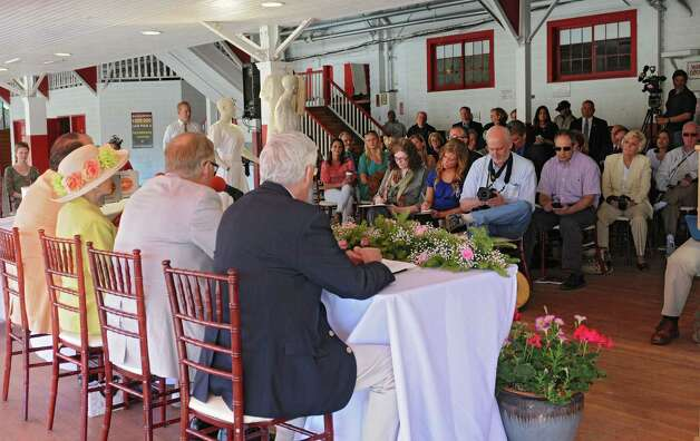 People attend a press conference celebrating 150 years of the Saratoga Race Course at the track on Thursday, May 16, 2013 in Saratoga Springs, N.Y. Committee Honorary Chairs and Chairman held the news conference to announce final, detailed plans for Saratoga?s five-month-long celebration. (Lori Van Buren / Times Union) Photo: Lori Van Buren / 10022450A