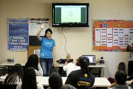 Andrea Lo, founder of Piggybackr, speaks to kids about her company at the Boys and Girls Club on Thursday, May 2, 2013 in Redwood City, Calif. Piggybackr is the Kickstarter for school-aged kids, helping them raise money for their school, sports teams, after-school programs and more.
