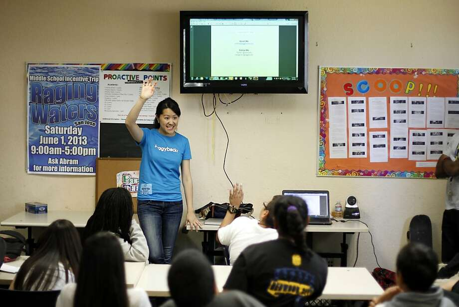 Piggybackr founder Andrea Lo speaks to Boys & Girls Club members in Redwood City about her S.F. startup, which is a fundraising site for school-age children. Youths use the site to crowdfund as much as $40,000 for clubs, sports teams and more. Photo: Beck Diefenbach, Special To The Chronicle