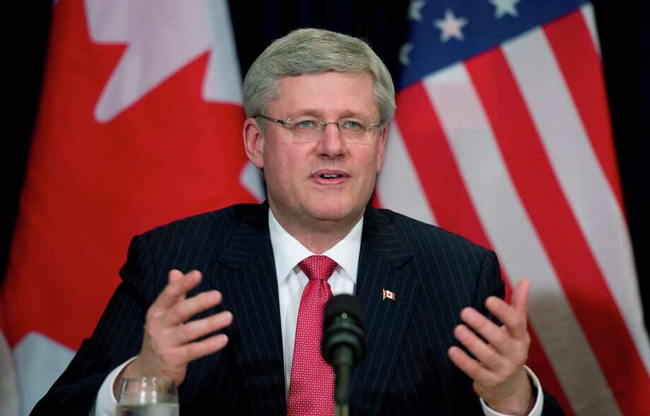 "Canadian Prime Minister Stephen Harper speaks to business leaders during a meeting in New York, Thursday May 16, 2013. Harper said Thursday that a controversial oil pipeline from his country to the U.S. Gulf Coast ""absolutely needs to go ahead"" and warned that the oil will be transported through America one way or another. (AP Photo/The Canadian Press, Adrian Wyld) Photo: Adrian Wyld, SUB / The Canadian Press"