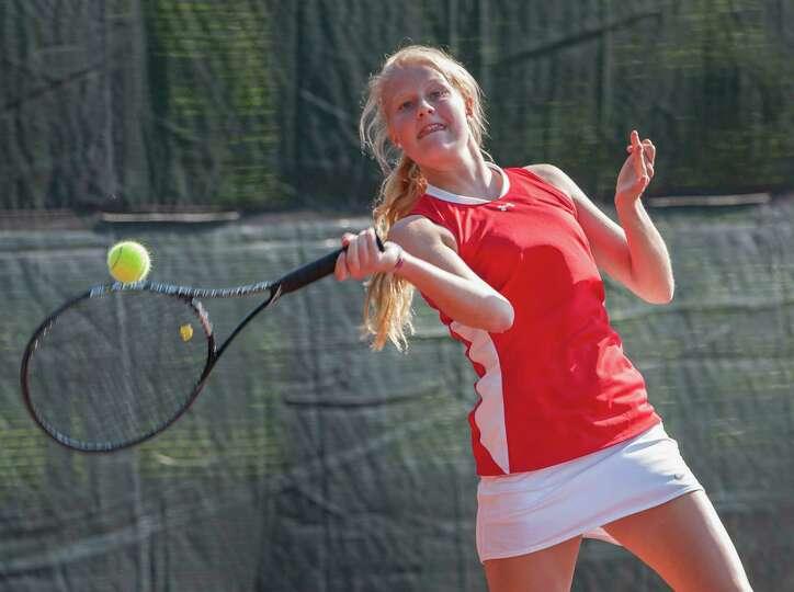 Greenwich high school's Julia Akerman returns a shot in a doubles match against Ridgefield high scho