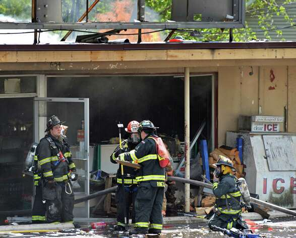 Firefighters battle a stubborn fire at the Handy Andy market and Vintage Pizza on Rt. 155 in Colonie, NY Thursday May 16, 2013.  (John Carl D'Annibale / Times Union) Photo: John Carl D'Annibale