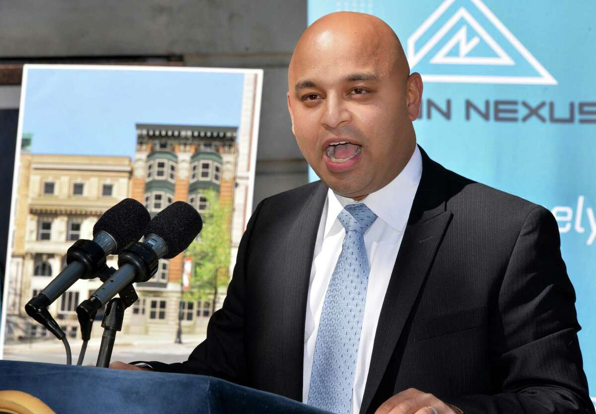 Omar Usmani, executive partner at Aeon Nexus Corporation speaks during the announcement that his firm will be among the first tenants of a new building at Wellington Row on State Street in Albany, NY Thursday May 16, 2013. (John Carl D'Annibale / Times Union)