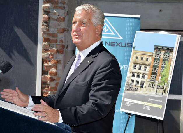 Albany Mayor Jerry Jennings speaks during the announcement of the first tenants of a new building at Wellington Row on State Street in Albany, NY Thursday May 16, 2013.  (John Carl D'Annibale / Times Union) Photo: John Carl D'Annibale / 00022464A
