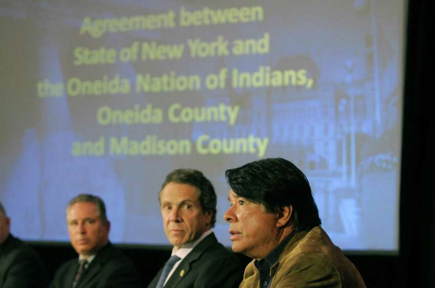 Howard Glaser, left, director of State Operations, Governor Andrew Cuomo, center, and Oneida Nation Representative Ray Halbritter take part in a press conference at the Capitol on Thursday, May 16, 2013 in Albany, NY. Governor Andrew Cuomo signed an agreement with the Oneida Nation on gaming and other issues. (Paul Buckowski / Times Union)