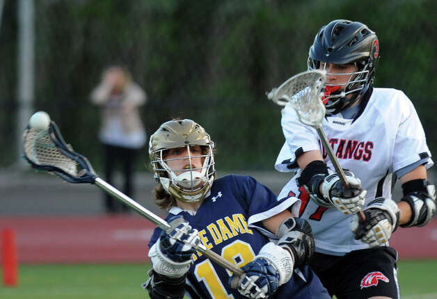 Boys lacrosse action between Fairfield Warde and Notre Dame of Fairfield in Fairfield, Conn. on Thursday May 16, 2013. Photo: Christian Abraham / Connecticut Post