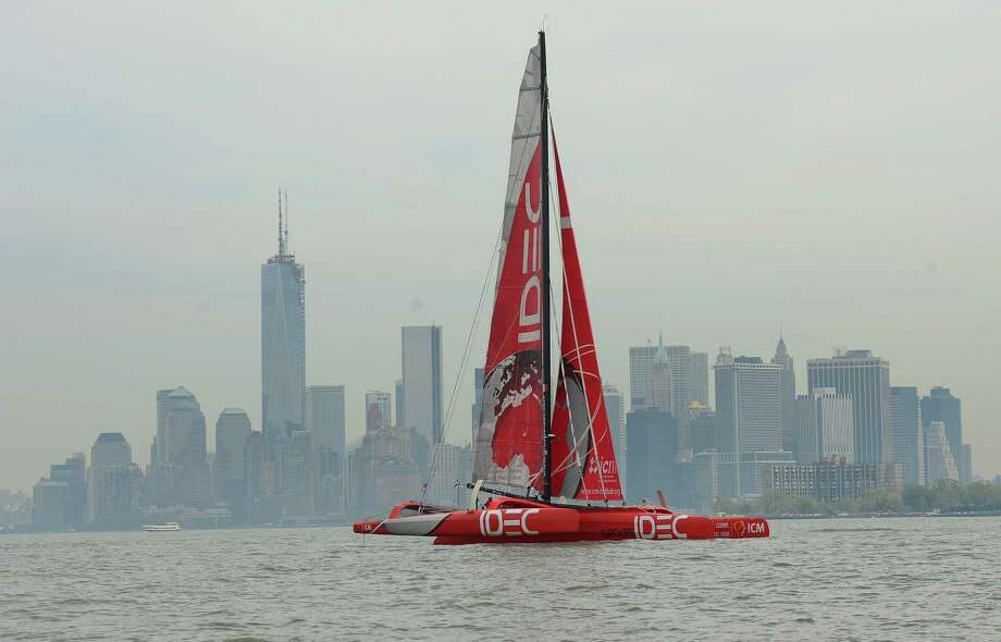 French professional sailor Francis Joyon sails his trimaran IDEC past Manhattan's skyline in New York, May 16, 2013. Joyon arrived in New York with his trimaran 'IDEC' as he waits for a weather window to challenge the solo trans-Atlantic record from New York to Cape Lizard, England. Joyon and IDEC, who hold the Single-Handed Round the World Record of 57 days, 13 hours and 34 minutes, will attempt to break the solo trans-Atlantic, held currently by fellow Frenchman Thomas Corville with 5 days, 19 hours and 20 second. AFP PHOTO/Emmanuel DunandEMMANUEL DUNAND/AFP/Getty Images Photo: EMMANUEL DUNAND