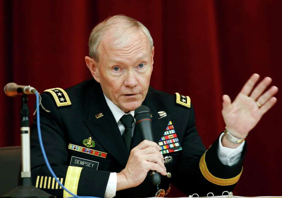 FILE - In this April 26, 2013, file photo, Chairman of the Joint Chiefs of Staff Gen. Martin Dempsey speaks during his lecture at Joint Staff College in Tokyo. One after another, the charges have tumbled out _ allegations of sexual assaults in the military that have triggered outrage, from local commanders to Capitol Hill and the Oval Office. But for the Pentagon there seem to be few clear solutions beyond improved training and possible adjustments in how the military prosecutes such crimes. Changing the culture of a male-dominated, change-resistant military that for years has tolerated sexism and sexist behavior is proving to be a challenging task. (AP Photo/Koji Sasahara, File) Photo: Koji Sasahara
