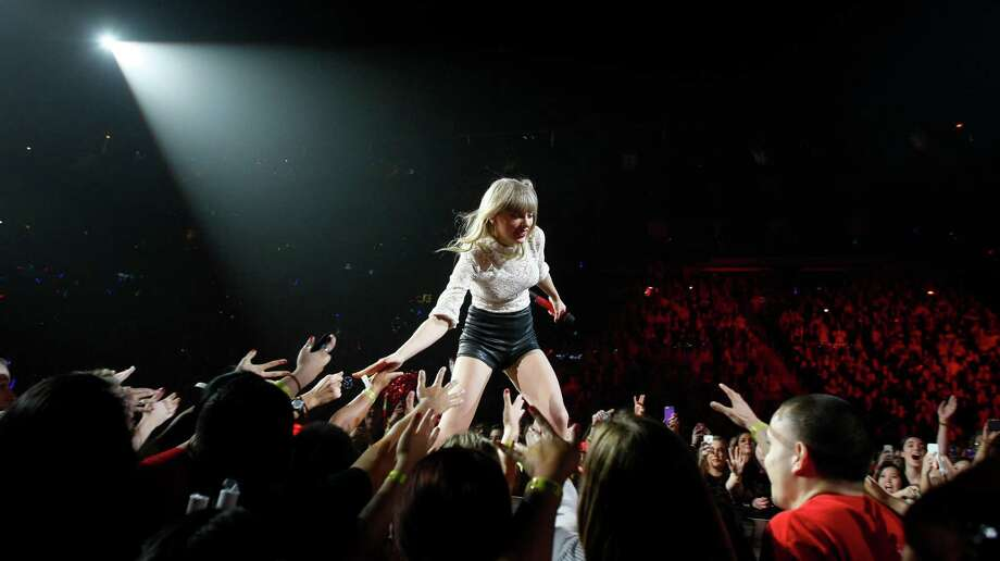 Taylor Swift performs in the Toyota Center on Thursday night as a part of the Red Tour. This time, the singer displayed a new-found confidence on stage. Photo: Nick De La Torre, Staff / © 2013 Houston Chronicle