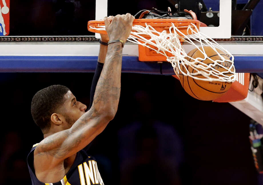 Indiana Pacers' Paul George dunks against the New York Knicks in the second half of Game 5 of an Eastern Conference semifinal in the NBA basketball playoffs, at Madison Square Garden in New York, Thursday, May 16, 2013. Photo: Julio Cortez