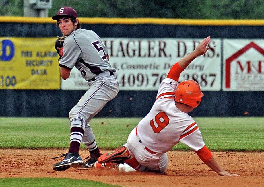 Silsbee second baseman Jordan Gore, #5, steps on second to get Orangefield player Dustin Selman, #9, out and looks to first for the double play during the Orangefield Class 3A quarterfinals baseball game against Silsbee on Thursday, May 16, 2013, in Vidor.  Photo taken: Randy Edwards/The Enterprise