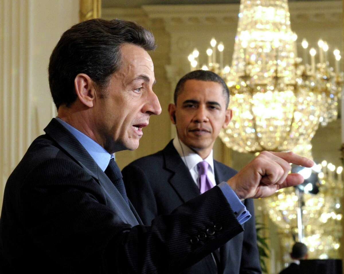 FILE - In this March 30, 2010 file photo, President Barack Obama listens as then-French President Nicolas Sarkozy speaks in the East Room of the White House in Washington. New documents show that Sarkozy and his wife Carla Bruni showered President Barack Obama and his family with more than $41,000 worth of gifts in 2011. (AP Photo/Susan Walsh, File)