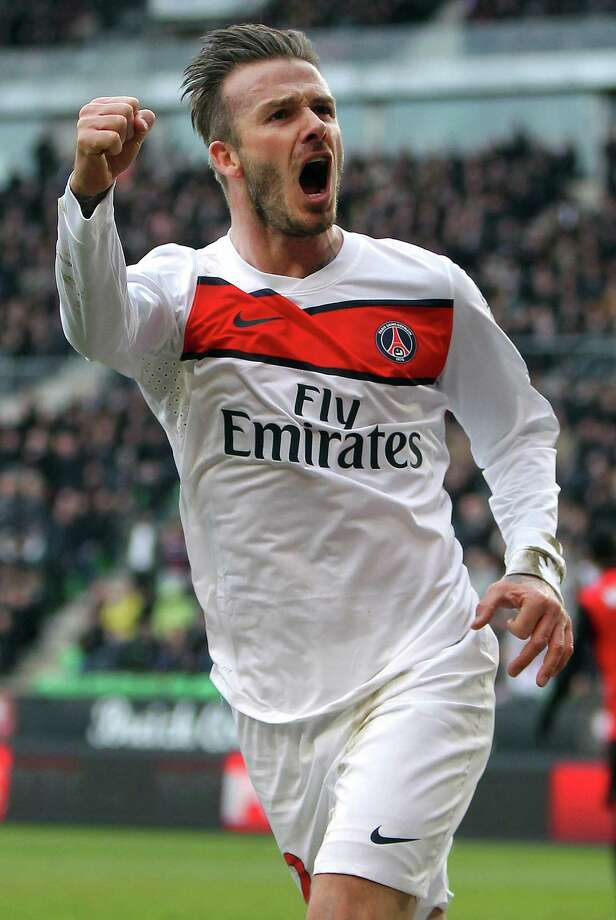 "FILE - In this April 6, 2013 file photo, PSG's David Beckham celebrates after scoring a goal against Rennes during their French League One soccer match, in Rennes, western France. David Beckham is retiring from soccer after the season, ending a career in which he become a global superstar since starting his career at Manchester United. The 38-year-old Englishman recently won a league title in a fourth country with Paris Saint-Germain. He said in a statement Thursday  May 16, 2013 he is ""thankful to PSG for giving me the opportunity to continue but I feel now is the right time to finish my career, playing at the highest level."" (AP Photo/David Vincent, File) Photo: David Vincent"