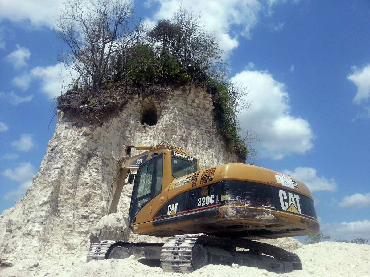 The head of the Belize Institute of Archaeology said the builders couldn't have mistaken the pyramid for a natural hill because the ruins are well-known and the landscape there is flat.