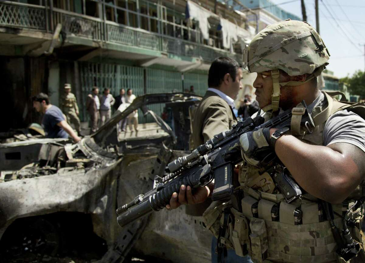 A U.S. soldier arrives to the scene where a suicide car bomber attacked American military vehicles in Kabul.