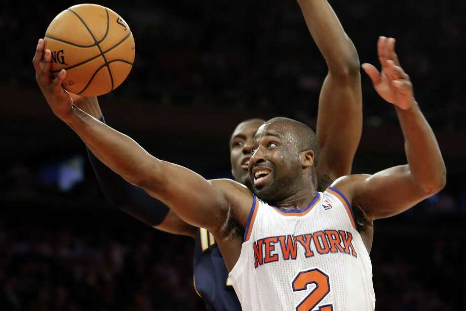 New York Knicks' Raymond Felton (2) goes up for a shot against Indiana Pacers' Ian Mahinmi in the second half of Game 5 of an Eastern Conference semifinal in the NBA basketball playoffs, at Madison Square Garden in New York, Thursday, May 16, 2013. (AP Photo/Julio Cortez) Photo: Julio Cortez