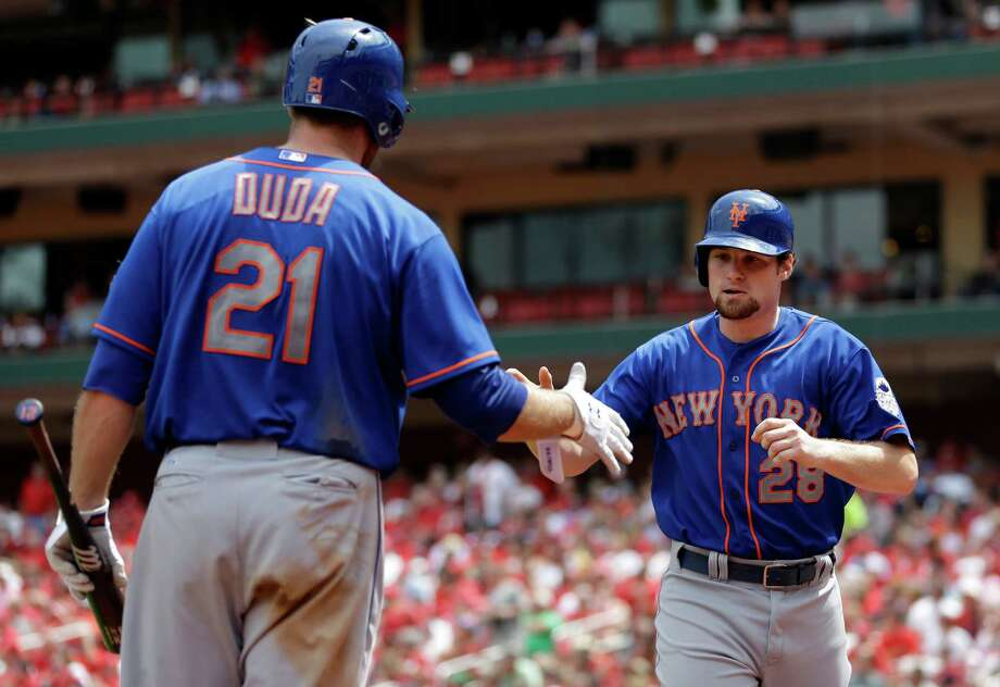 New York Mets' Daniel Murphy, right, is congratulated by teammate Lucas Duda after scoring during the sixth inning of a baseball game against the St. Louis Cardinals Thursday, May 16, 2013, in St. Louis. (AP Photo/Jeff Roberson) Photo: Jeff Roberson