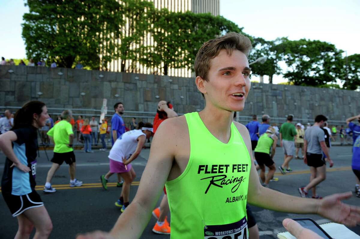 Alex Leuchanka of Fleet Feet, center, wins in the men's division during the Workforce Team Challenge run on Thursday, May 16, 2013, in Albany, N.Y. (Cindy Schultz / Times Union)