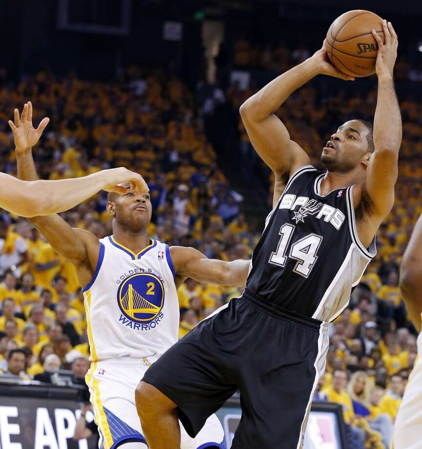 The Spurs' Gary Neal shoots around the Warriors' Jarrett Jack during first half action of Game 6 in the NBA Western Conference semifinals Thursday May 16, 2013 at Oracle Arena in Oakland, CA.