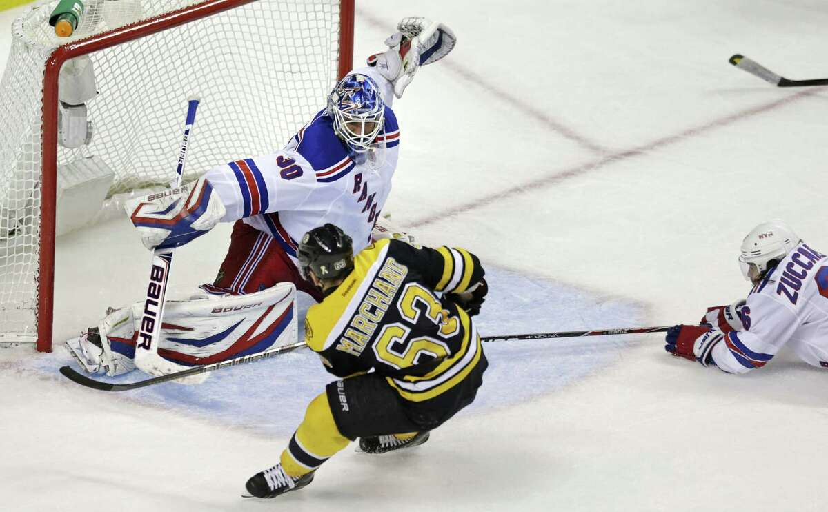 Bruins left wing Brad Marchand beats Rangers goalie Henrik Lundqvist for the game-winning goal during overtime in Game 1 of their best-of-7 series.