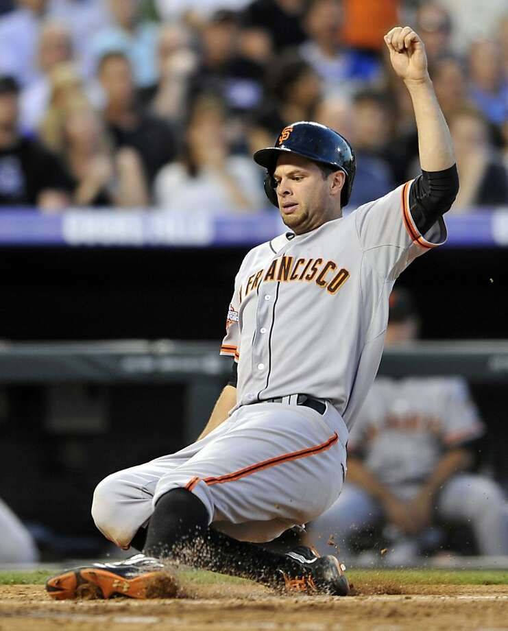 Brandon Belt scores on a Brandon Crawford double in the fourth inning at Coors Field. Photo: Jack Dempsey, Associated Press