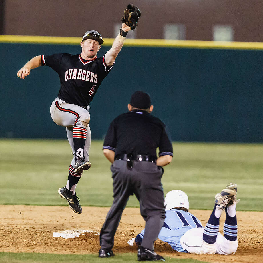 Johnson's Mark Whitehead (bottom) steals second base as Churchill shortstop Zane Gurwitz, a Texas signee, makes the catch in Johnson's 6-3 win in Game 1 of a third-round playoff series. Photo: Marvin Pfeiffer / San Antonio Express-News