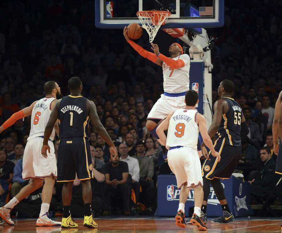 Knicks forward Carmelo Anthony scores two of his game-high 28 points against the Pacers during Game 5. New York is trying to become the ninth NBA team to overcome a 3-1 deficit to win a series. Photo: Barton Silverman / New York Times