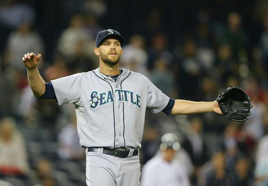 Tom Wilhelmsen celebrates after earning his 11th save in 11 chances with a scoreless ninth for Seattle. Photo: Al Bello / Getty Images