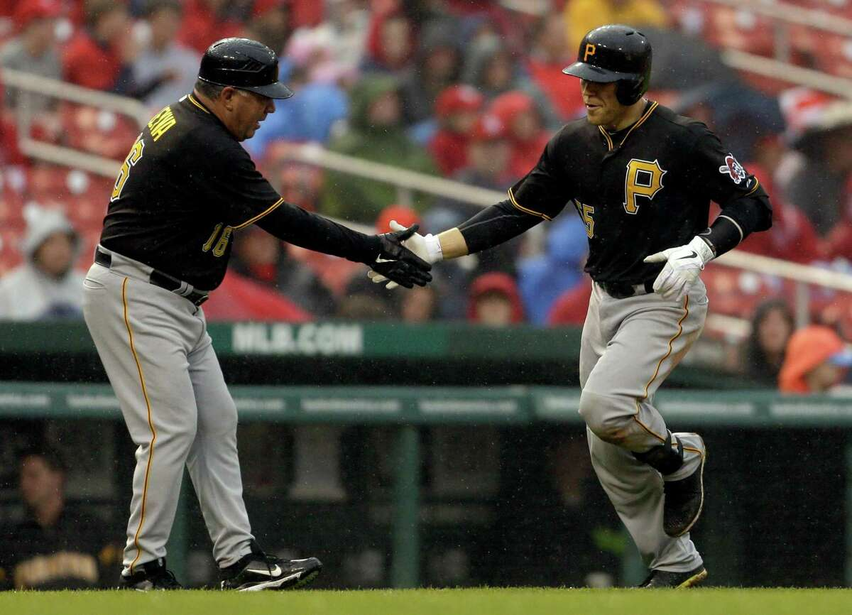 Pittsburgh Pirates' Russell Martin, right, is congratulated by third base coach Nick Leyva after hitting a two-run home run during the seventh inning of a baseball game against the St. Louis Cardinals Saturday, April 27, 2013, in St. Louis. (AP Photo/Jeff Roberson)