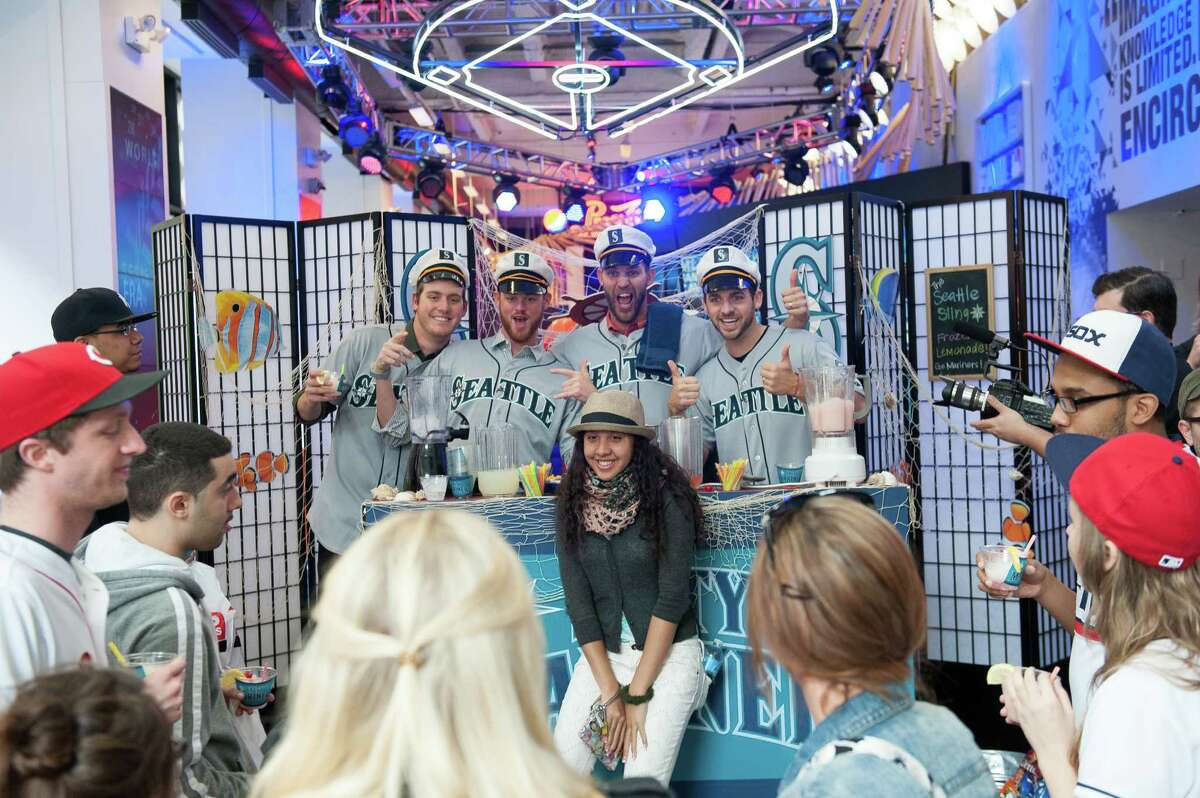 Charlie Furbush, Tom Wilhelmsen, Lucas Luetge, and Brandon Maurer of the Seattle Mariners pose with a fan while filming a sketch.