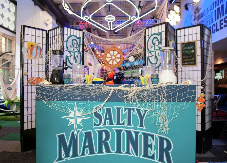 The bar is set for Charlie Furbush, Tom Wilhelmsen, Lucas Luetge, and Brandon Maurer of the Seattle Mariners before their visit to the MLB Fan Cave. Photo: Thomas Levinson, MLB Photos Via Getty Images / 2013 Major League Baseball Photos