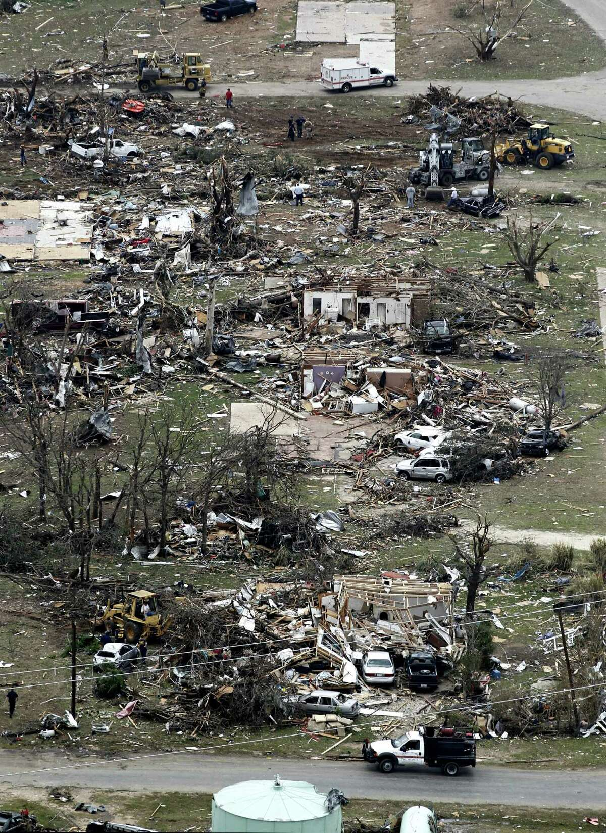 Ten tornadoes touched down in several small communities, including Granbury, in North Texas on Wednesday night, leaving at least six people dead.