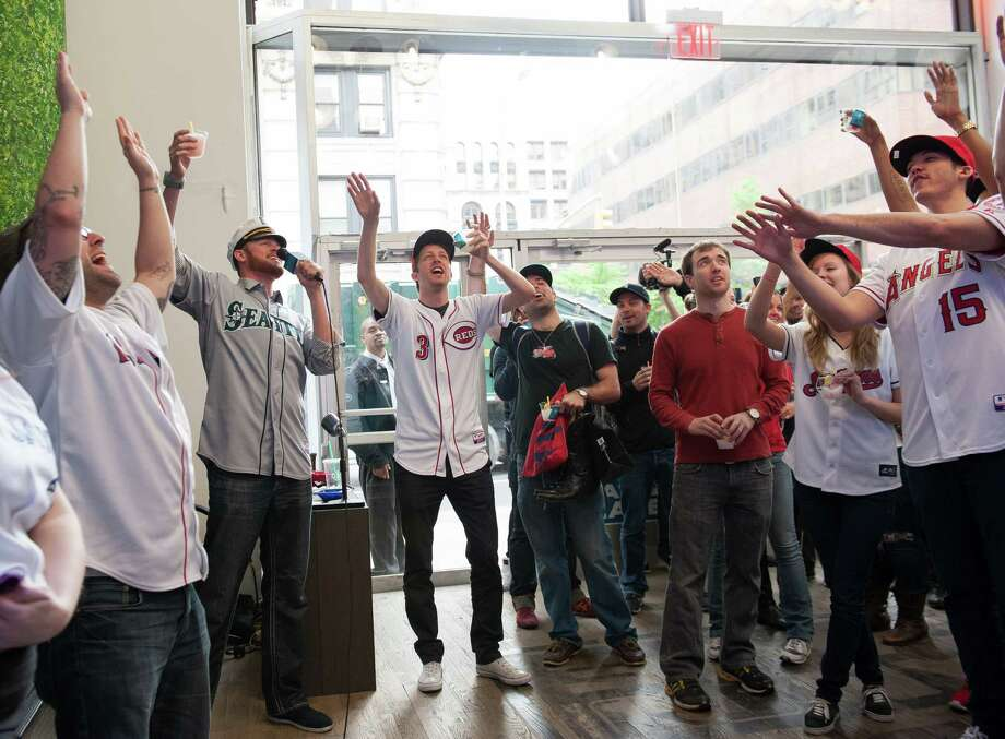 Charlie Furbush of the Seattle Mariners sings karaoke with the MLB Fan Cave Dwellers and fans while filming a sketch. Photo: Thomas Levinson, MLB Photos Via Getty Images / 2013 Major League Baseball Photos