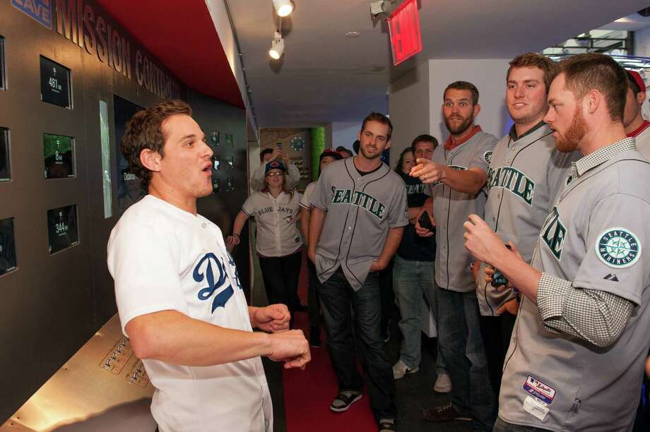 Dweller Aaron Roberts explains Mission Control to Lucas Luetge, Tom Wilhelmsen, Brandon Maurer, and Charlie Furbush of the Seattle Mariners. Photo: Thomas Levinson, MLB Photos Via Getty Images / 2013 Major League Baseball Photos