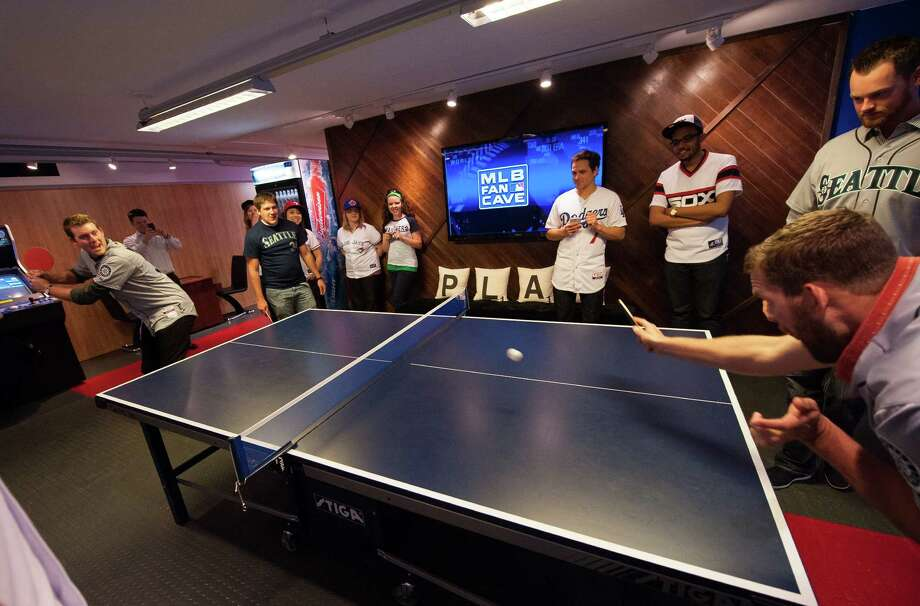 Brandon Maurer and Tom Wilhelmsen of the Seattle Mariners play table tennis. Photo: Thomas Levinson, MLB Photos Via Getty Images / 2013 Major League Baseball Photos