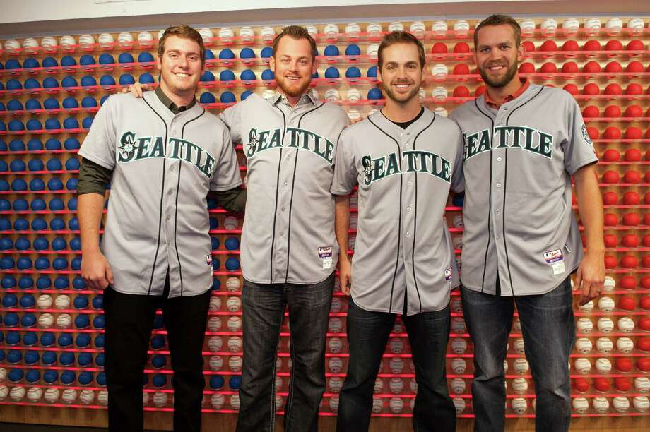 Brandon Maurer, Charlie Furbush, Lucas Luetge, and Tom Wilhelmsen  of the Seattle Mariners pose in front of the Rawlings Ball Wall. Photo: Thomas Levinson, MLB Photos Via Getty Images / 2013 Major League Baseball Photos