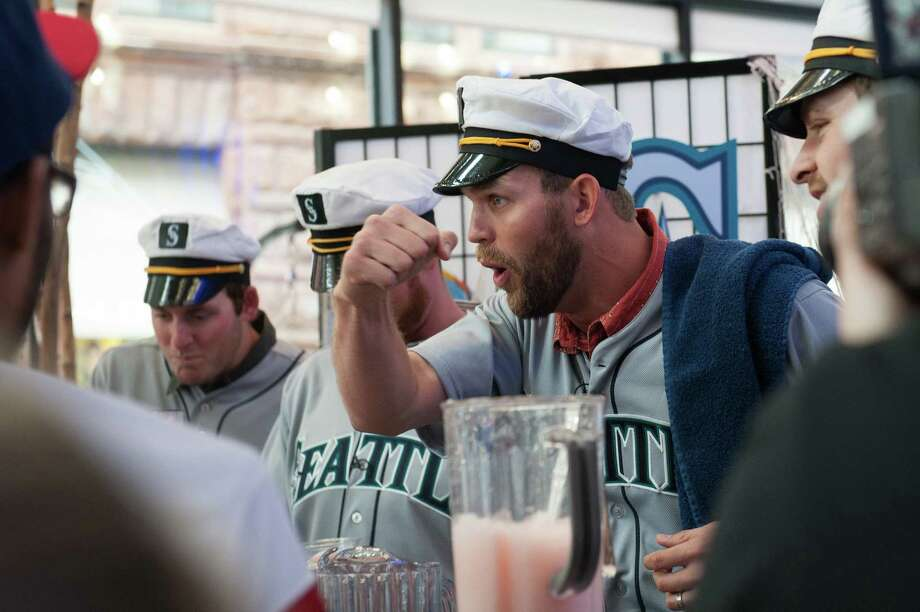 Tom Wilhelmsen gets the crowd singing with Charlie Furbush, Lucas Luetge, and Brandon Maurer of the Seattle Mariners while filming a sketch. Photo: Thomas Levinson, MLB Photos Via Getty Images / 2013 Major League Baseball Photos